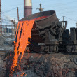 The molten steel is poured into the slag dump. — ストック写真