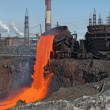 The molten steel is poured into the slag dump. - Stock Photo