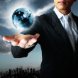 Holding globe in his hands — Stock Photo