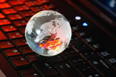 Globe on keyboard — Stock Photo