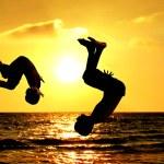 Children jumping sea — Stock Photo #10567422