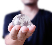 Holding globe in his hand — Stock Photo