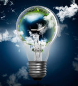 Light bulb with globe — Stock Photo