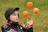 The boy plays with balls — Stock Photo