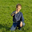 The happy child on a green grass — Stock Photo
