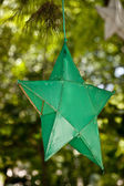 Green paper star on the three — Stock Photo