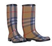 Fashionable red plaid rubber boots — Stock Photo