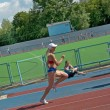 Regional competition in Athletics Champion Juniors of Urals, young women athletes running around the stadium Dynamo. — Stock Photo