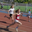 Regional competition in Athletics Champion Juniors of Urals, young women athletes running around the stadium Dynamo. - Zdjcie stockowe