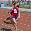 Regional competition in Athletics Champion Juniors of Urals, young women athletes running around the stadium Dynamo. - Foto Stock