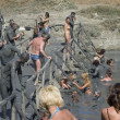 Feast of the gifts of nature, take curative mud in the mud volcano. — Stock Photo