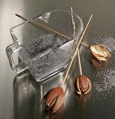 Poppy seeds and empty poppy heads — Stock Photo