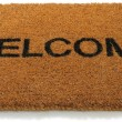 Welcome front door mat isolated on a white background — Zdjęcie stockowe