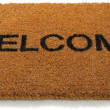 Welcome front door mat isolated on a white background — Stok fotoğraf
