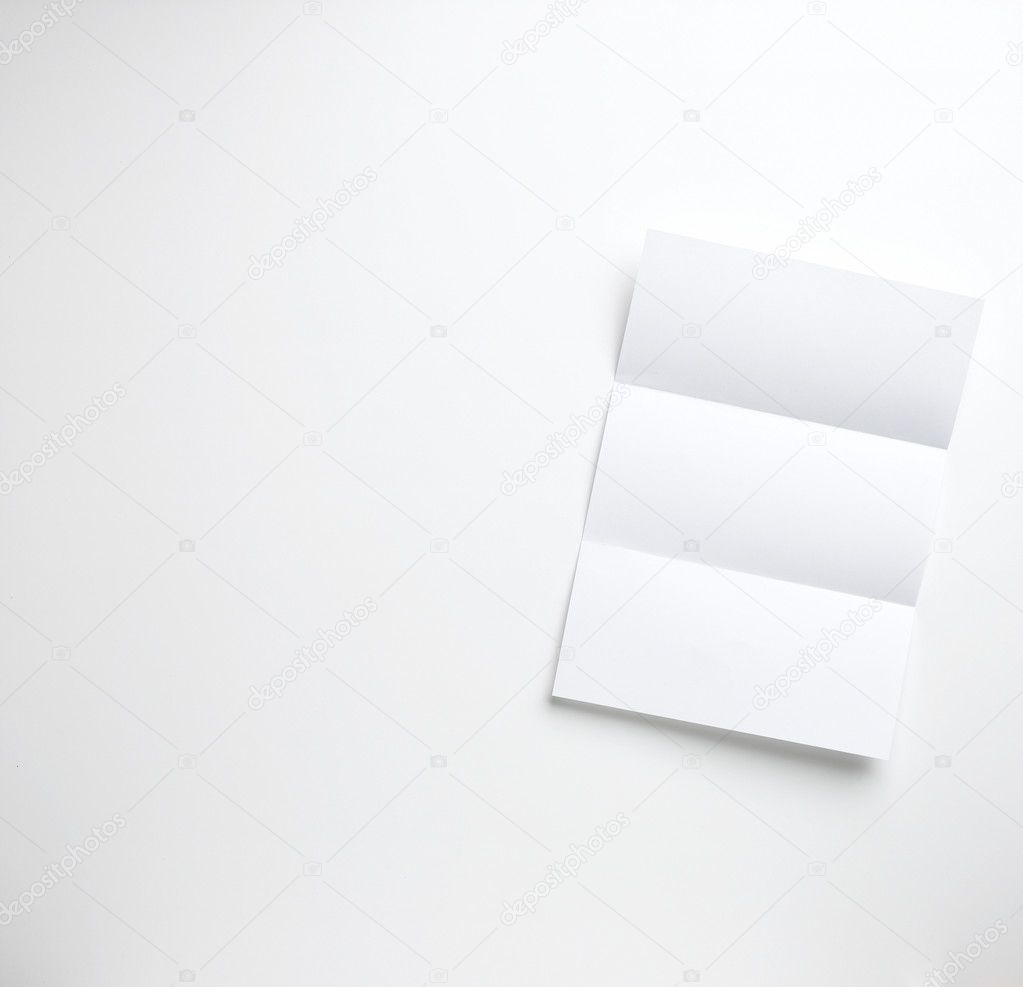 A sheet of blank folded letter paper copyspace on a white background ready for your copy — Stock Photo #10309750