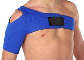 Patient wearing a shoulder bandage — Stock Photo