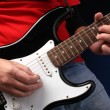 Playing electric guitar — Stockfoto