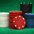 Gambling chips over green felt — Stock Photo #10313854