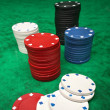 Gambling chips over green felt — Stock Photo #10313896