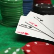 Four aces with gambling chips - Stock Photo