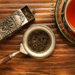 Antique chinese cup and a blend of tea leaves - Stock Photo