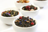 Various bowls of premiun tea leaves blends — Stock Photo
