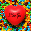 Photo: Soft red heart over candy background