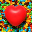Soft red heart over candy background — Stockfoto #10421772