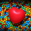 图库照片: Soft red heart over candy background