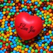 Soft red heart over candy background — Stock Photo #10421805