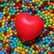 Soft red heart over candy background — 图库照片