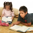 Brother and sister reading books on the floor — Stock Photo #10422474