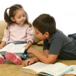 Brother and sister reading books on the floor — Stock Photo #10422563