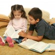 Brother and sister reading books on the floor — Stock Photo #10422606