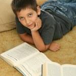 Boy reading books on the floor — Stock Photo #10422809
