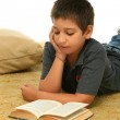 Boy reading a book on the floor — Stock Photo #10422872