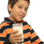 Boy drinking a glass of milk — Stock Photo #10423173