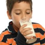 Boy drinking a glass of milk — Stock Photo #10423282
