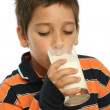 Foto Stock: Boy drinking glass of milk