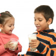 Stock Photo: Brother and sister drinking milk