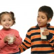 Brother and sister drinking milk — Stock Photo #10423410