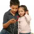 Children enjoying a mp4 player together — Stock Photo #10423670