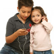 Children enjoying a mp4 player together — Stock Photo #10423685