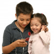 Children enjoying a mp4 player together — Stock Photo #10423704