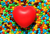 Soft red heart over candy background — Stock Photo