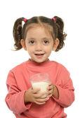 Cute little girl drinking milk — Stock Photo
