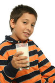 Boy drinking a glass of milk — Stock Photo
