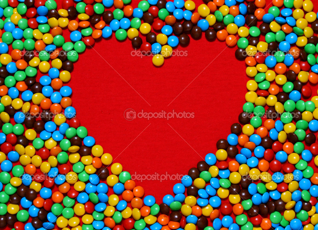 Colorful candy background making heart shape from my Valentine series — Стоковая фотография #10421739