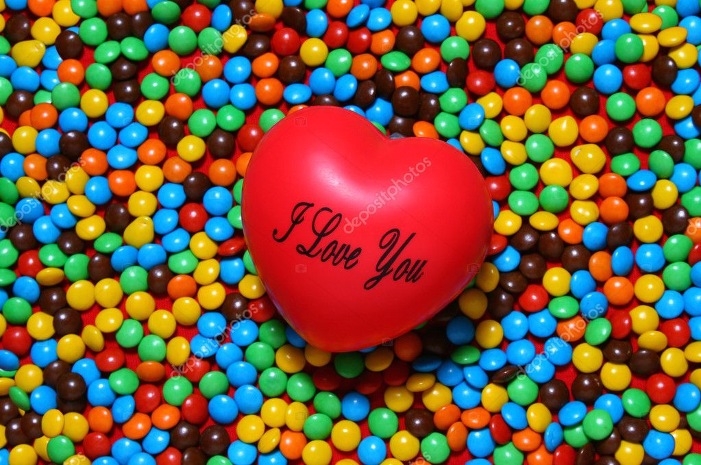 Colorful candy background with a red heart from my Valentine series — Lizenzfreies Foto #10421805