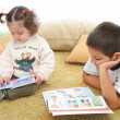 Royalty-Free Stock Photo: Brother and sister reading books on the floor